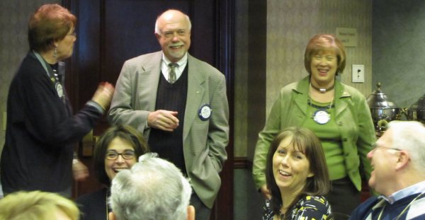 Members of the Rotary Club of Mason and Deerfield enjoy a laugh together.